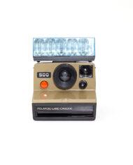 Polaroid 500 Land camera bruine body + flashbar
