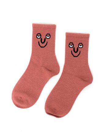 Roze sokken met relaxed gezicht