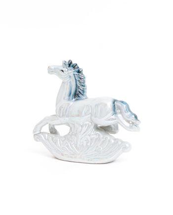 Vintage beeld van een springend paard blauw holografisch