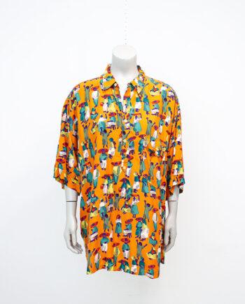 Vintage oranje blouse met kleurrijke print van figuurtjes